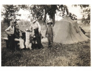 The Holland family camping in 1936 while they waited for a cabin to open at Rice's Landing on Little Mantrap Lake.