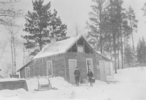 Raymond and Elmer Jr. at the original house during the frigid winter of 1936-1937.
