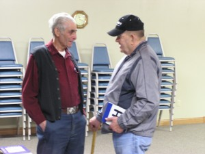 Frank Mitchell talks to David Wilander about the Jefferson Highway route through Becida, Minnesota. The route was abandoned when U. S. 71 was designated in 1926. David holds one of ten wooden blue,black, and white Jefferson Highway signs that Frank made and distributed as door prizes. Frank has lived along the Jefferson Highway all of his life and shares a unique family history that astonishes those who are fortunate to speak with him about it. (click to enlarge)