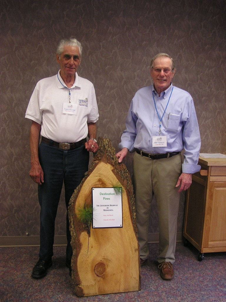 A slab from a white pine cut in 1975. Frank Mitchell and I have used it to advertise Jefferson Highway presentations. The grove that contained this tree would have been visible to the sociability caravan of 1916 as it exited Little Falls, MN (click to enlarge)
